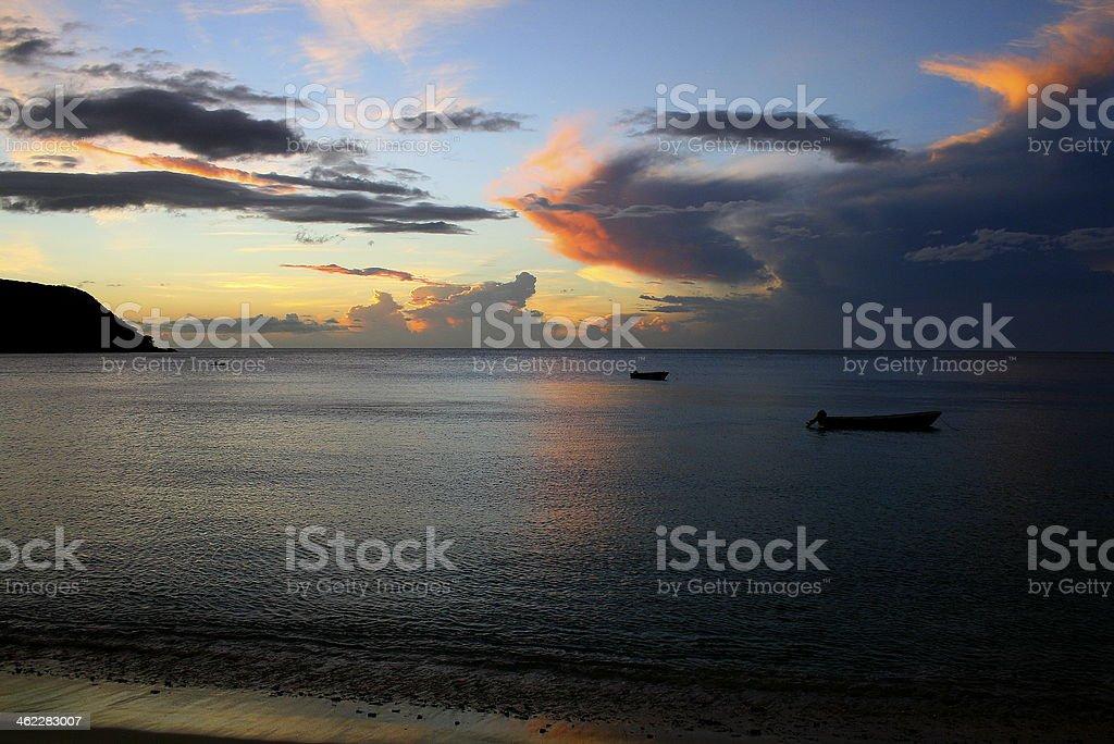 Peaceful sunset at a beach in Fiji stock photo