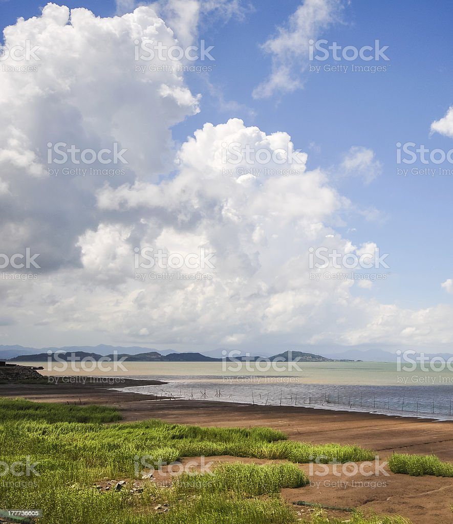 peaceful view of cloudscape over shallow beach royalty-free stock photo