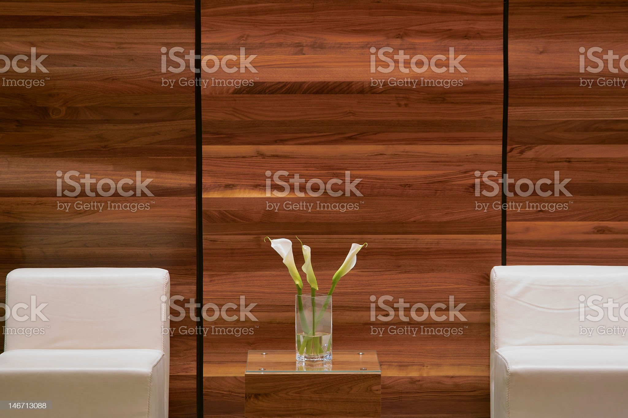 Peaceful waiting room with white chairs and white flowers  royalty-free stock photo