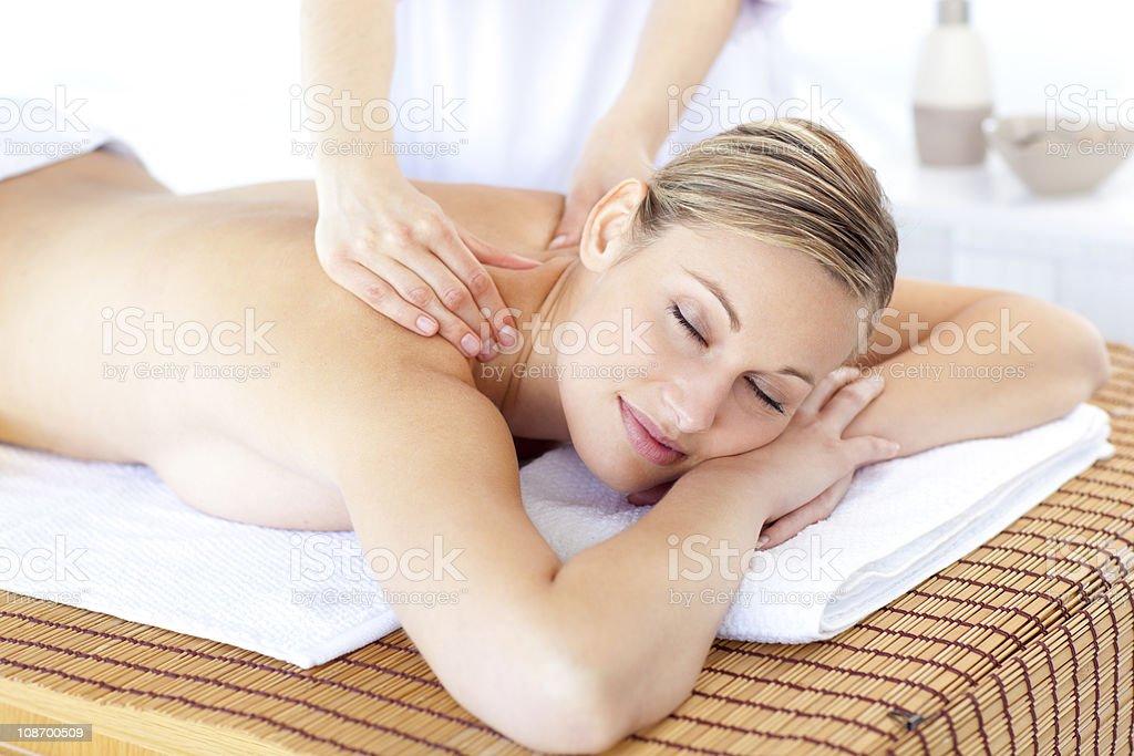 peaceful woman having a back massage royalty-free stock photo