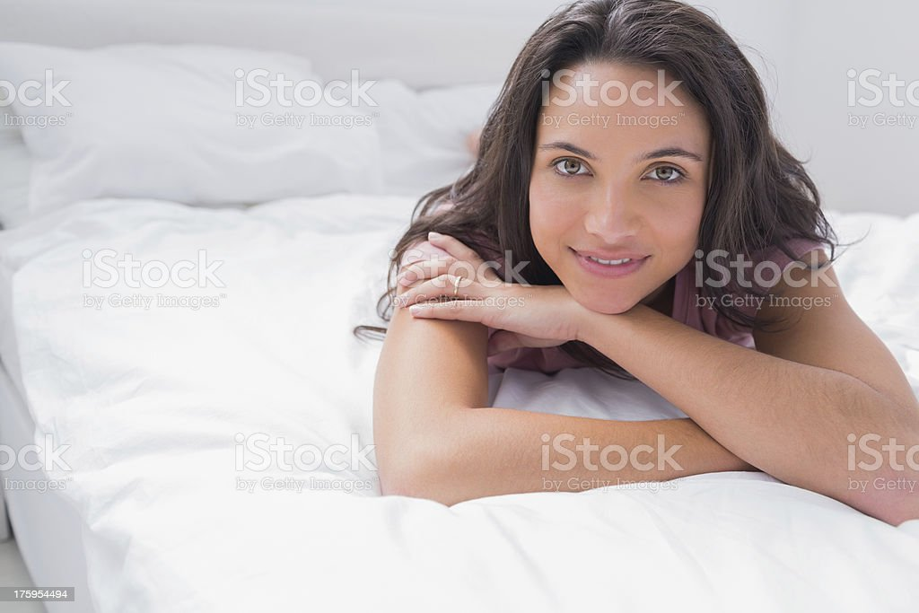 Peaceful woman lying on her bed royalty-free stock photo