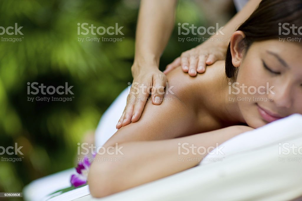 Peaceful woman receiving a massage on her back royalty-free stock photo