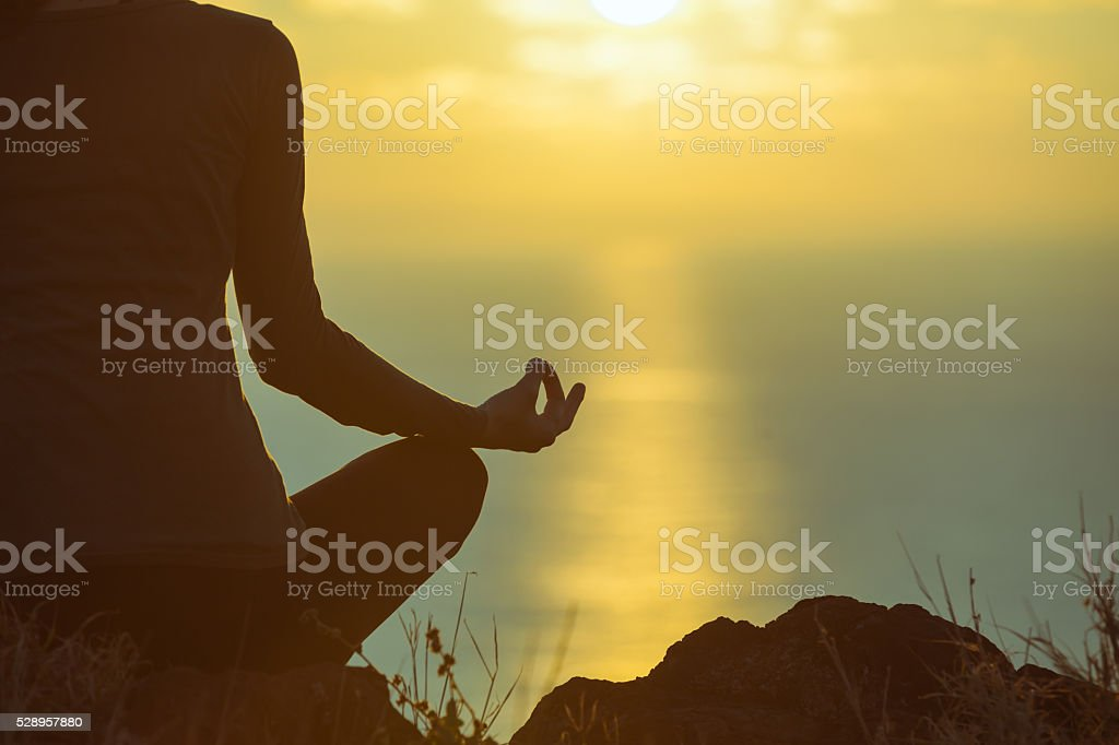 Peaceful yoga by the sea stock photo