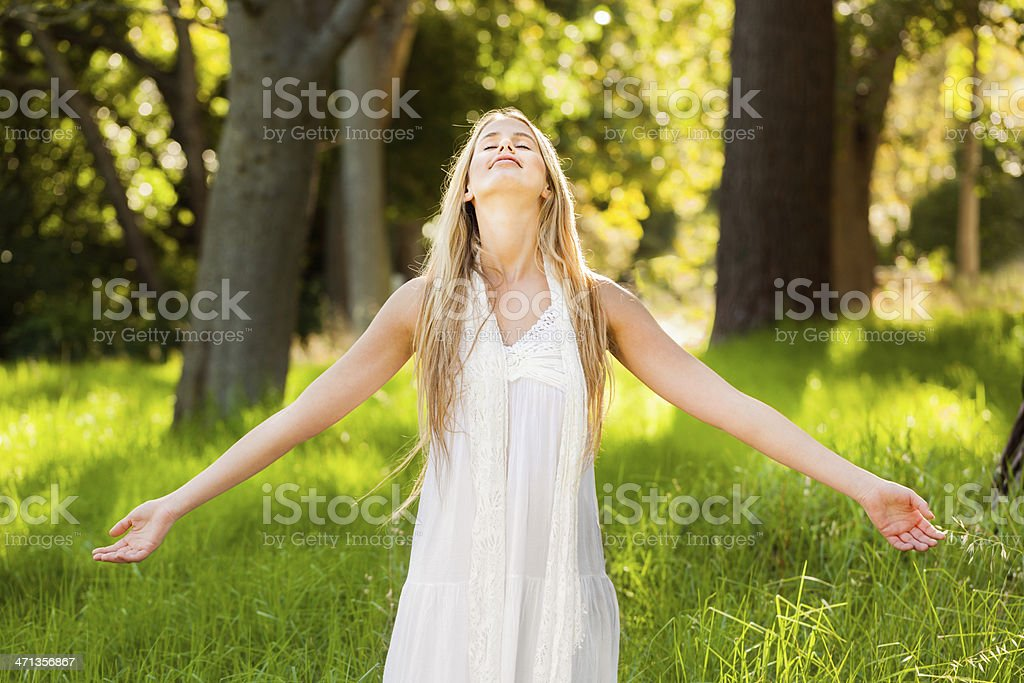 Peaceful Young Woman Enjoying Nature In Garden royalty-free stock photo