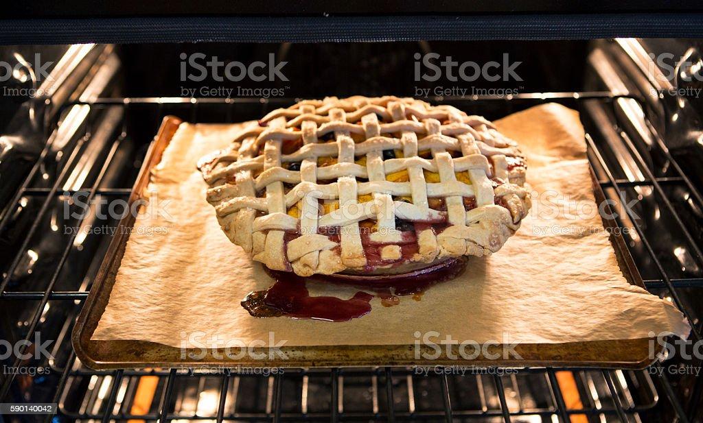Peach and Blueberry Lattice Pie stock photo