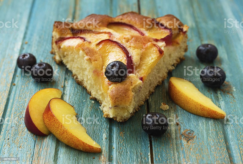 Peach and blueberry pie stock photo