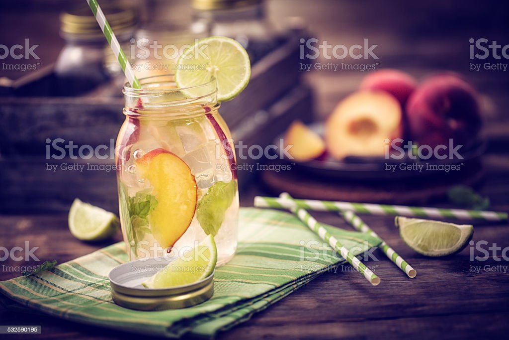 Peach Cocktail Served in a Glass Jar stock photo