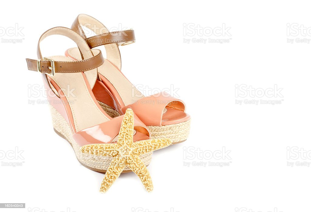 Peach Colored Wedge Sandals and Star Fish royalty-free stock photo