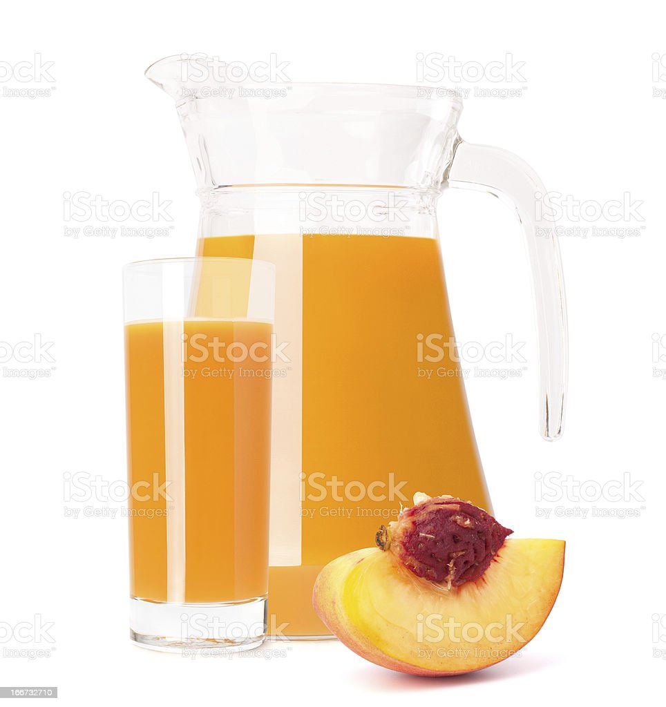 Peach fruit juice in glass jug royalty-free stock photo
