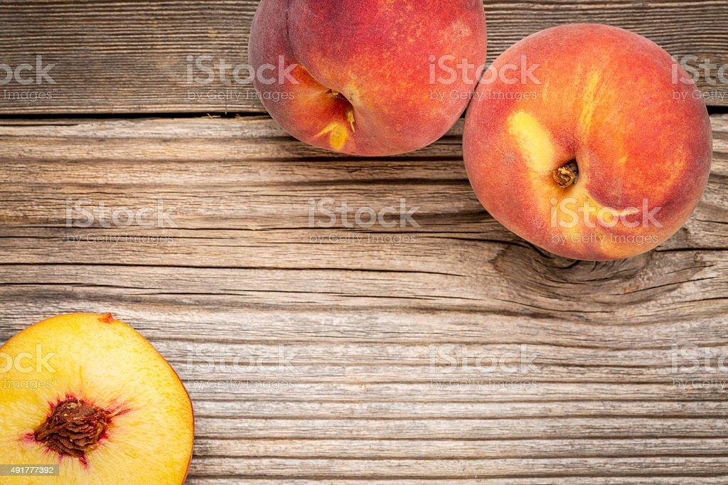 peach fruits on weathered wood stock photo