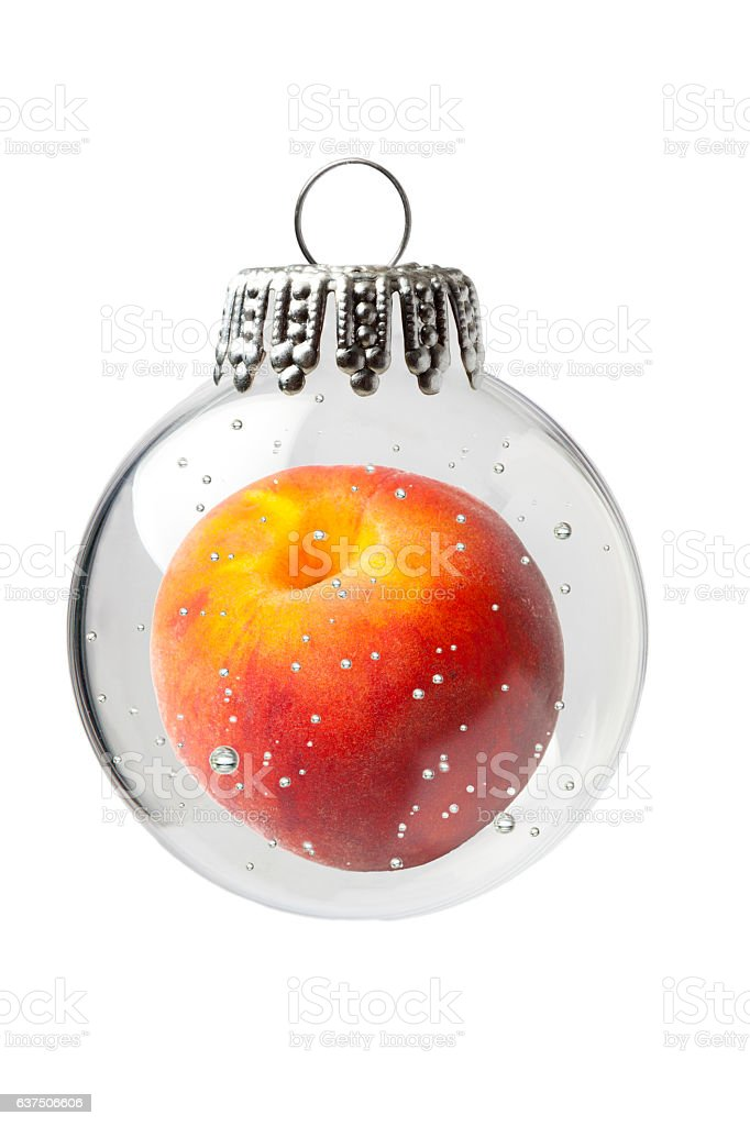 Peach in a Christmas Ornament stock photo