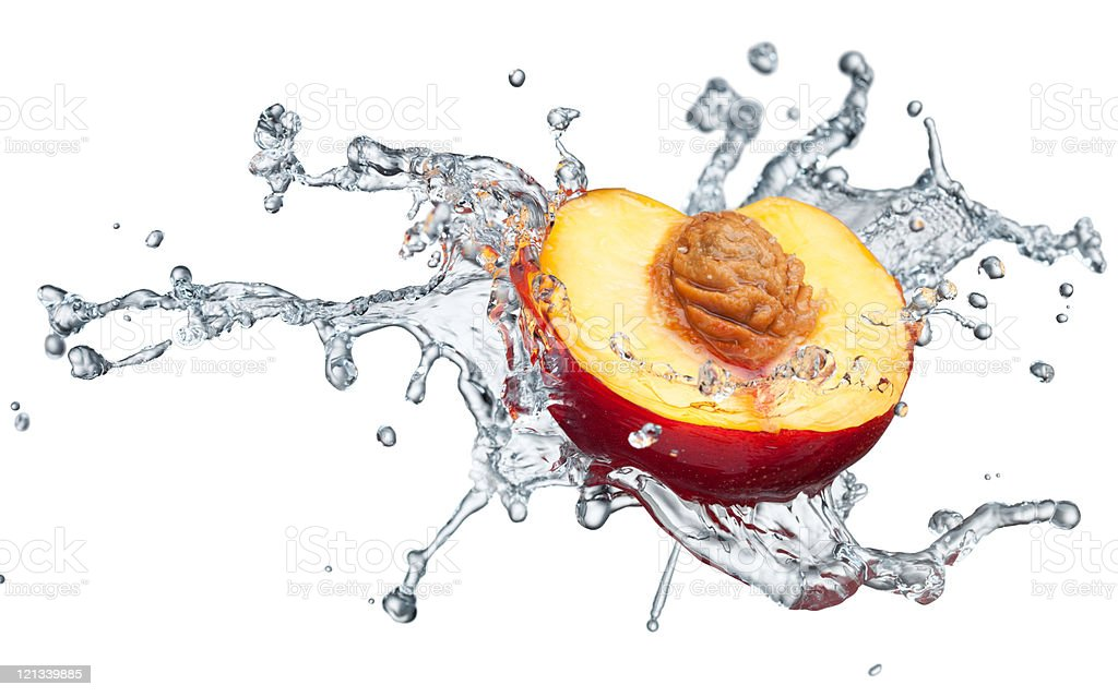 Peach in spray of water. royalty-free stock photo