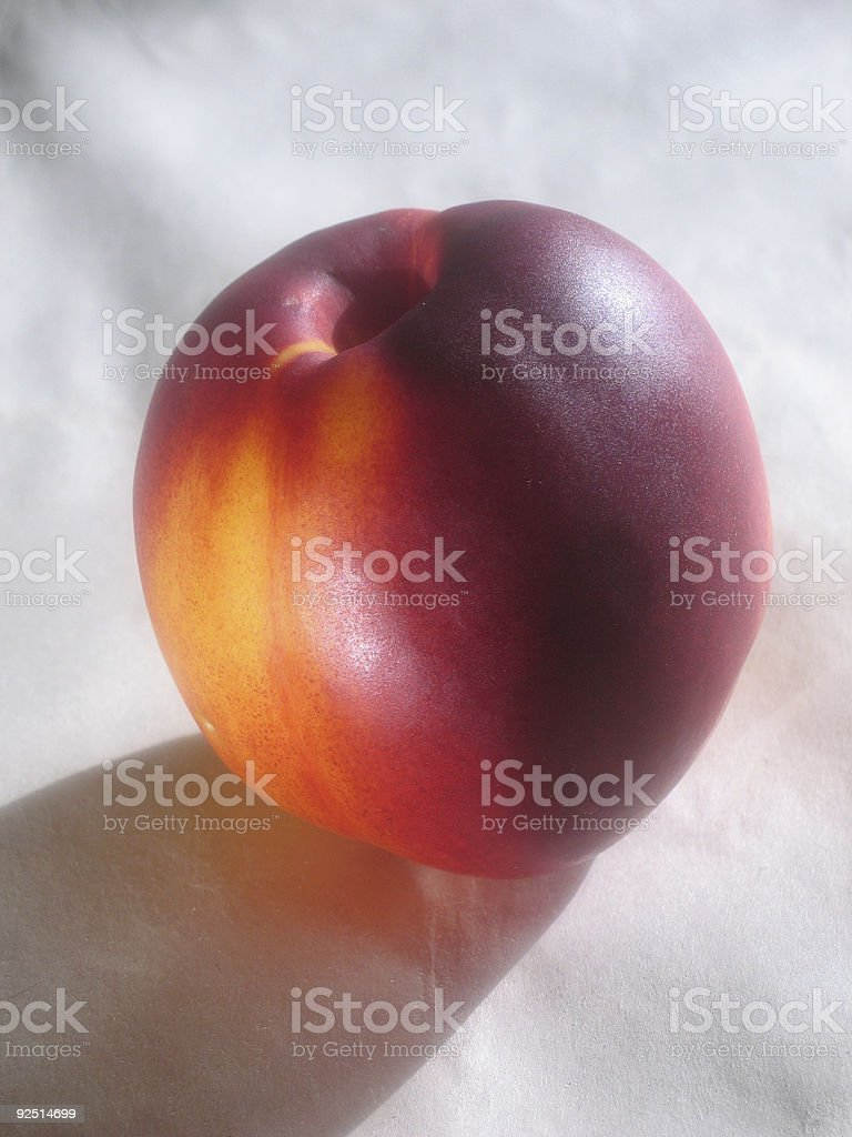 peach isolated on paper stock photo
