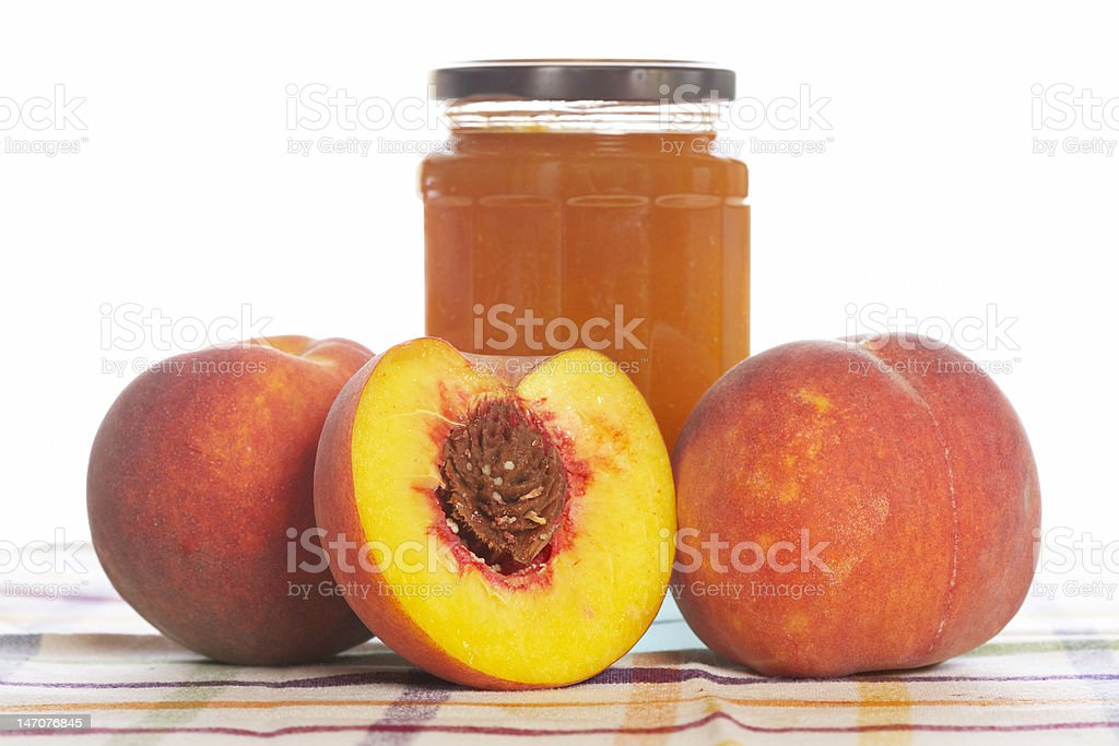 Peach jam and some fresh fruits stock photo