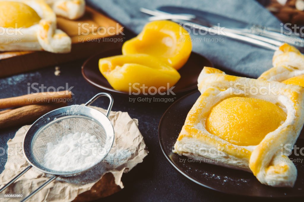 Peach pie and the ingredients. Shooting in the dark style stock photo