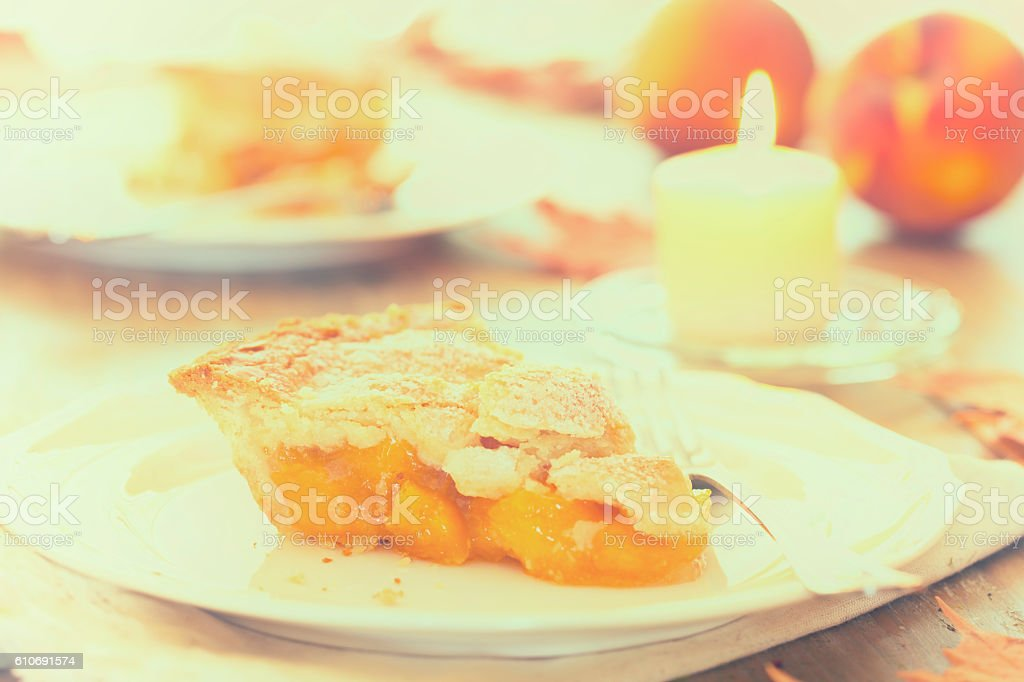 Peach Pie on Old White Wood Background stock photo