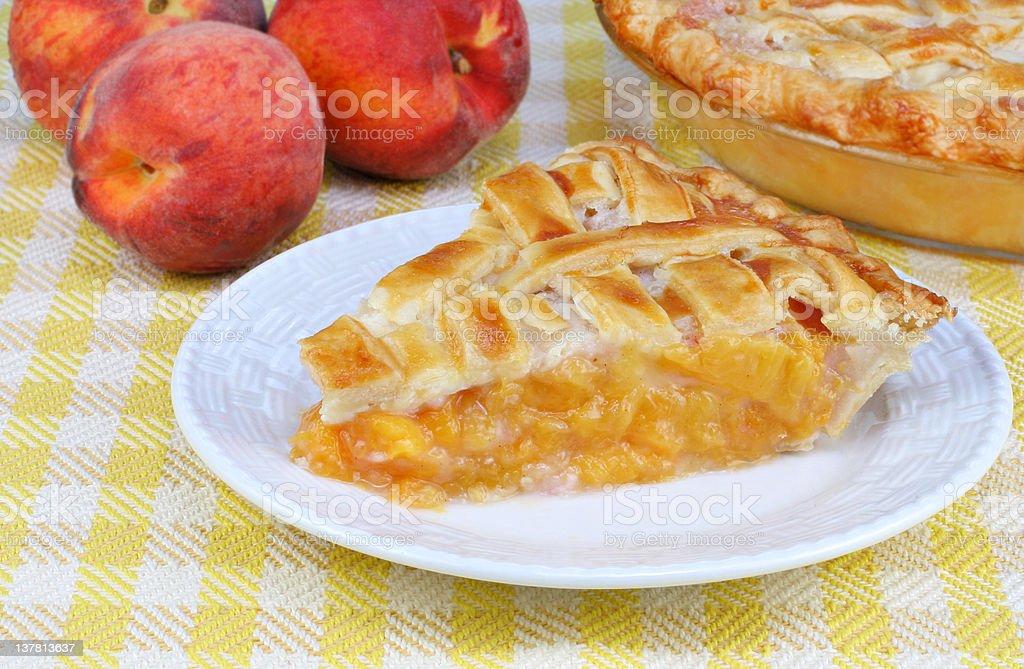 Peach Pie Slice and Peaches stock photo