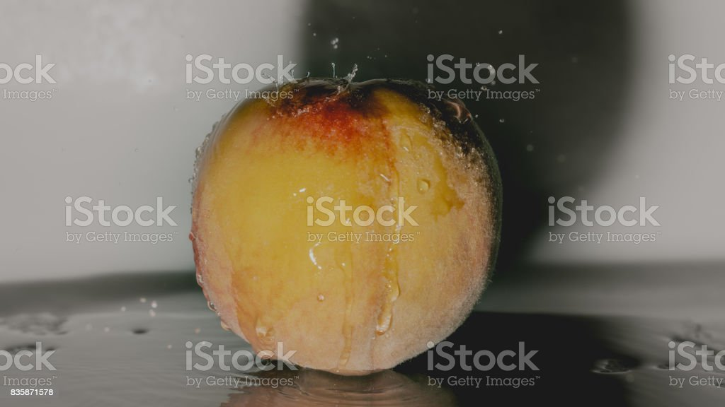 Peach under water stock photo