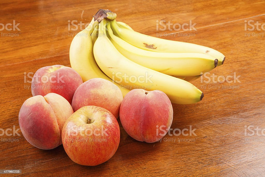 Peaches and Bananas with Apple royalty-free stock photo
