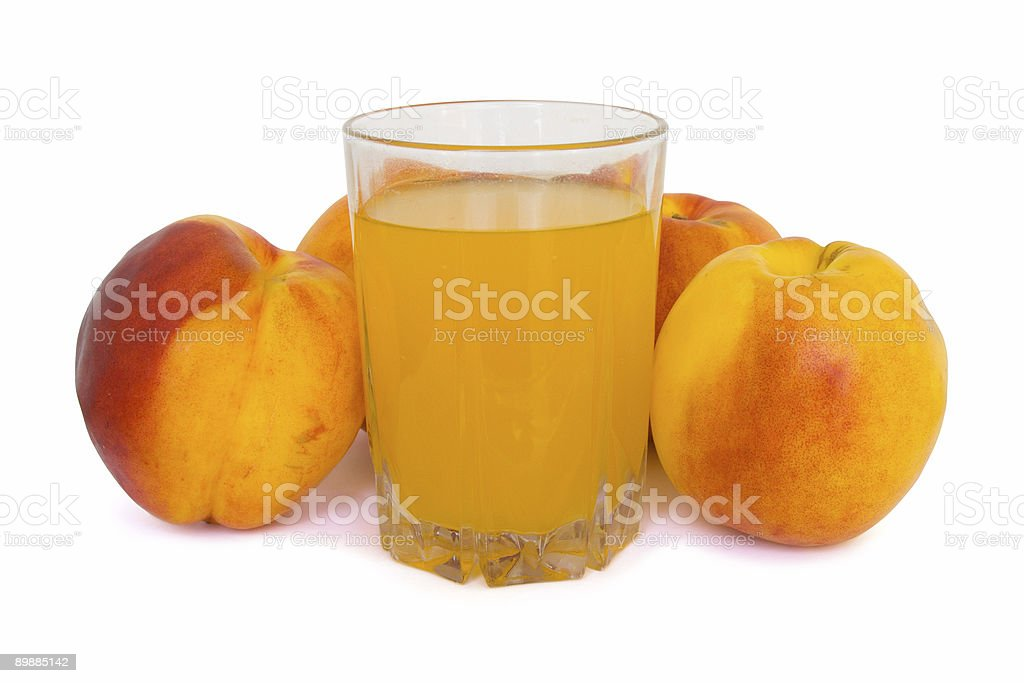 Peaches and glass of juice royalty-free stock photo