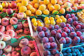 Peaches and plums for sale