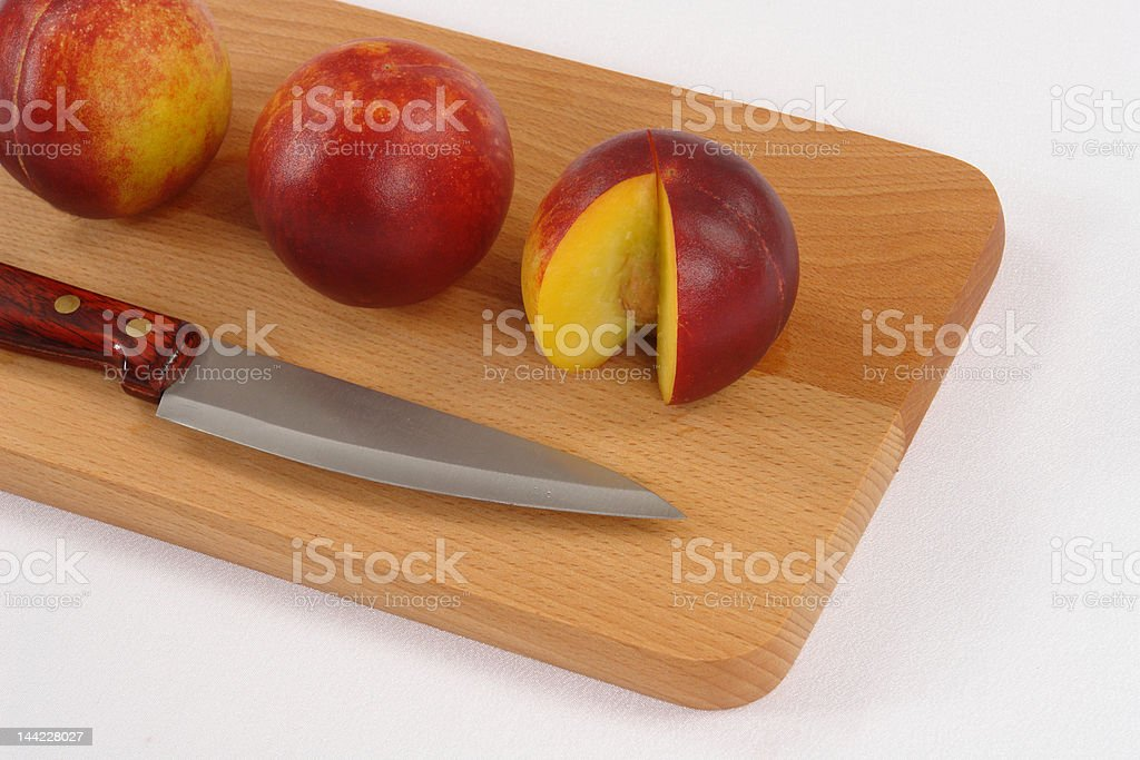 peaches at the table royalty-free stock photo