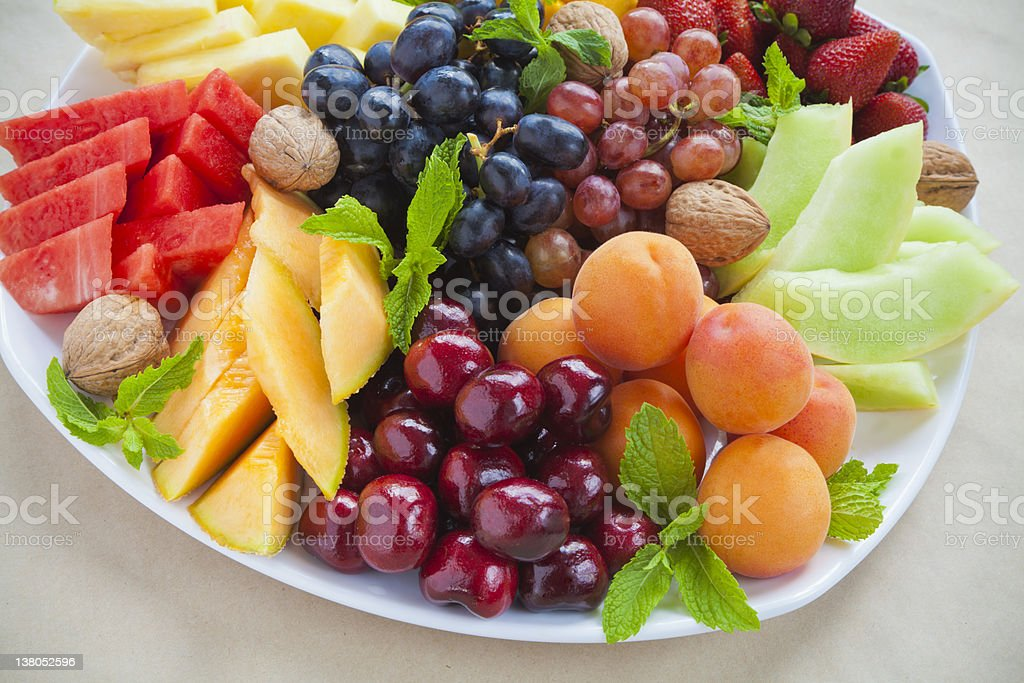 Peaches cherries melon strawberries and grapes on a platter stock photo