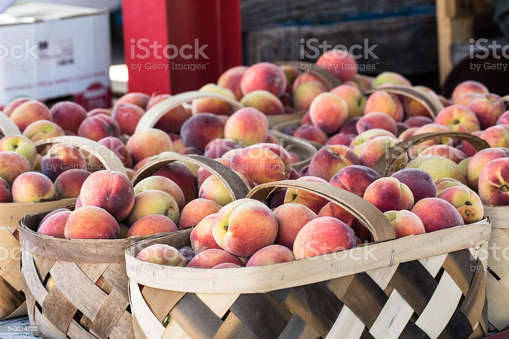 Peaches In Baskets at Farmers Market stock photo