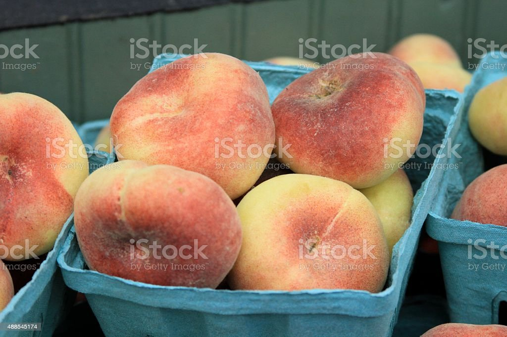 Peaches in the market stock photo