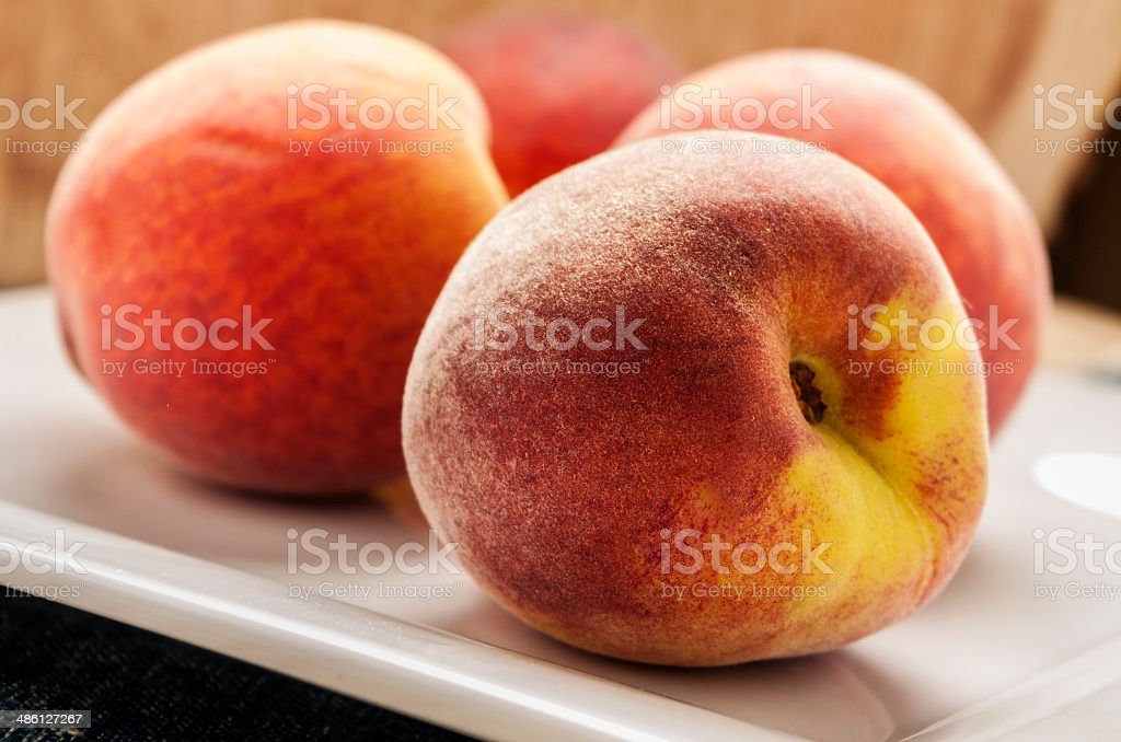 peaches in white plate royalty-free stock photo