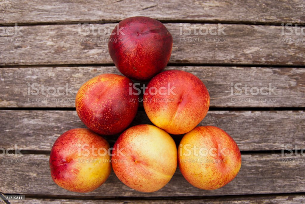 Peaches Isolated on Weathered Wood Background royalty-free stock photo