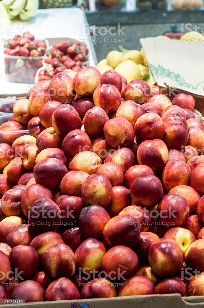 Peaches on display stock photo