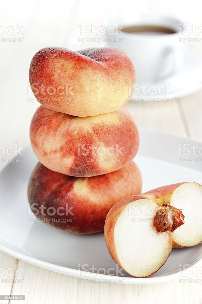 Peaches on the white plate royalty-free stock photo