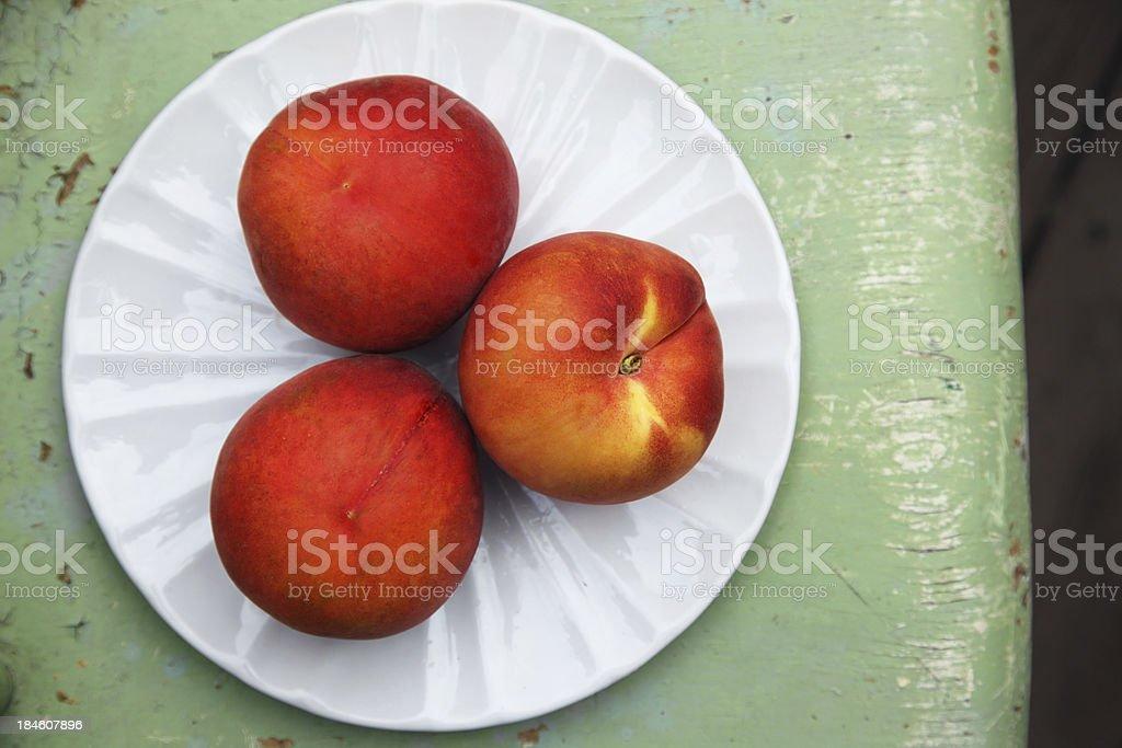 Peaches on White Plate stock photo