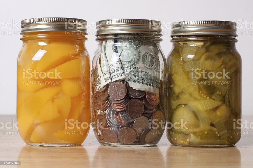 Peaches, Pickles, Money in Home Food Preservation Glass Storage Jars royalty-free stock photo