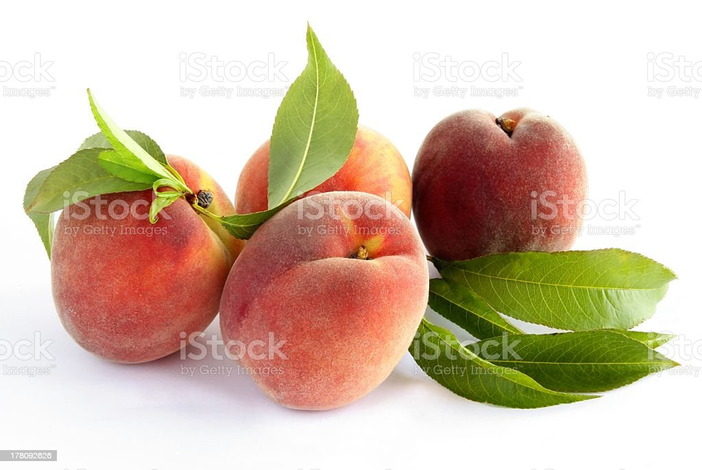 peaches with green leaves straight from orchard royalty-free stock photo