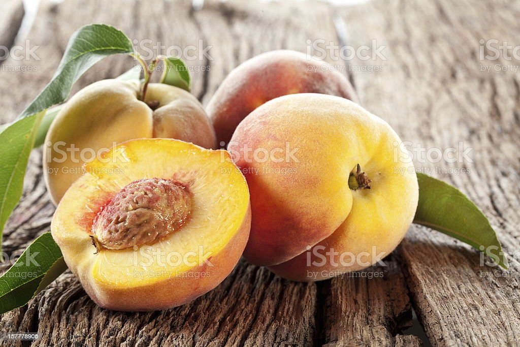 Peaches with leaves. royalty-free stock photo