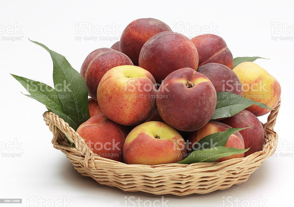 Peaches with leaves royalty-free stock photo