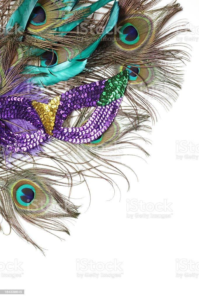 Peacock feathers and a purple mask stock photo