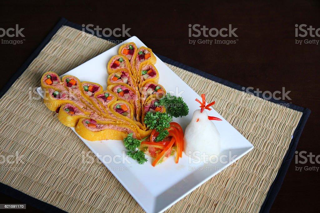 Peacock shape decoration of Vegetarian Fried rolls stock photo