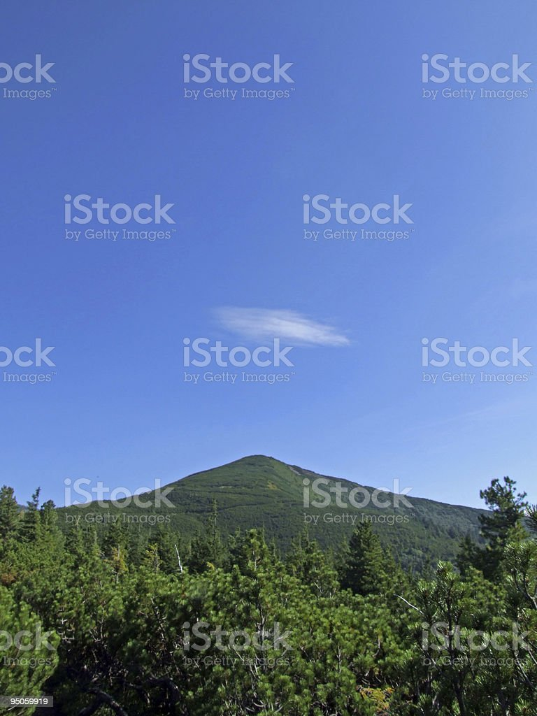 Peak and cloud royalty-free stock photo