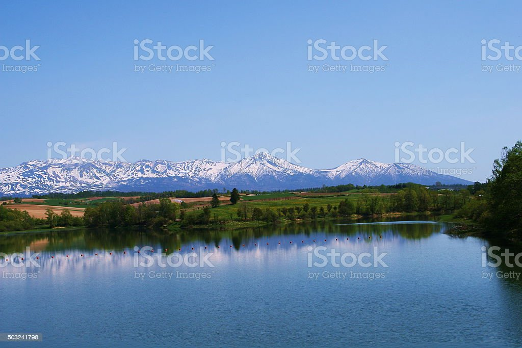 peak crowned with remaining snow in biei hokkaido .jp stock photo