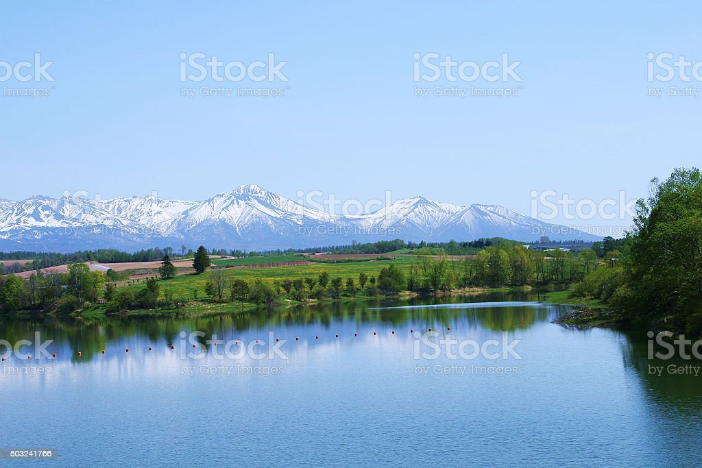 peak crowned with remaining snow stock photo