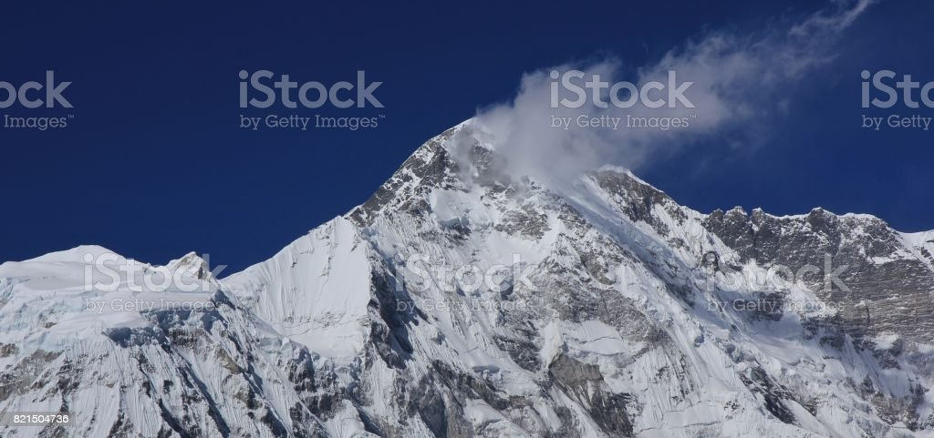Peak of mount Cho Oyu covered by glacier. stock photo