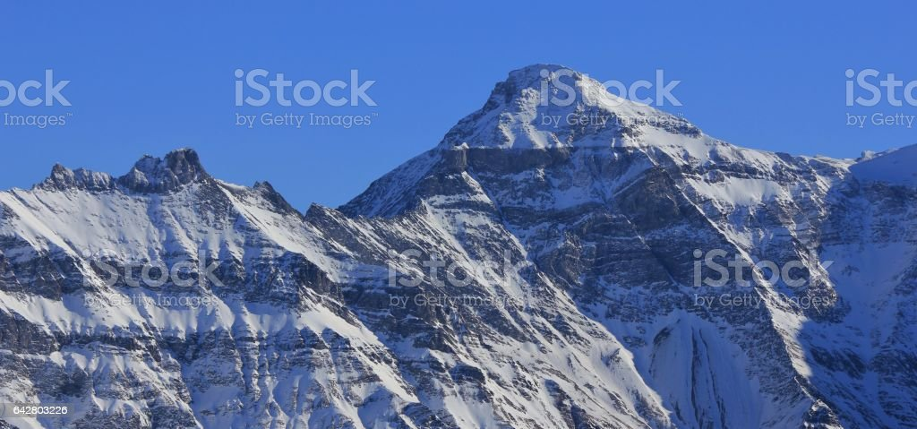 Peak of mount Hausstock in winter stock photo