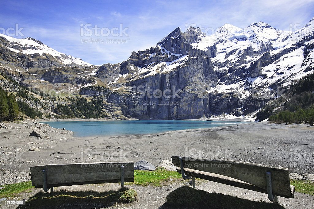 Peaks and lake in swiss Alps stock photo