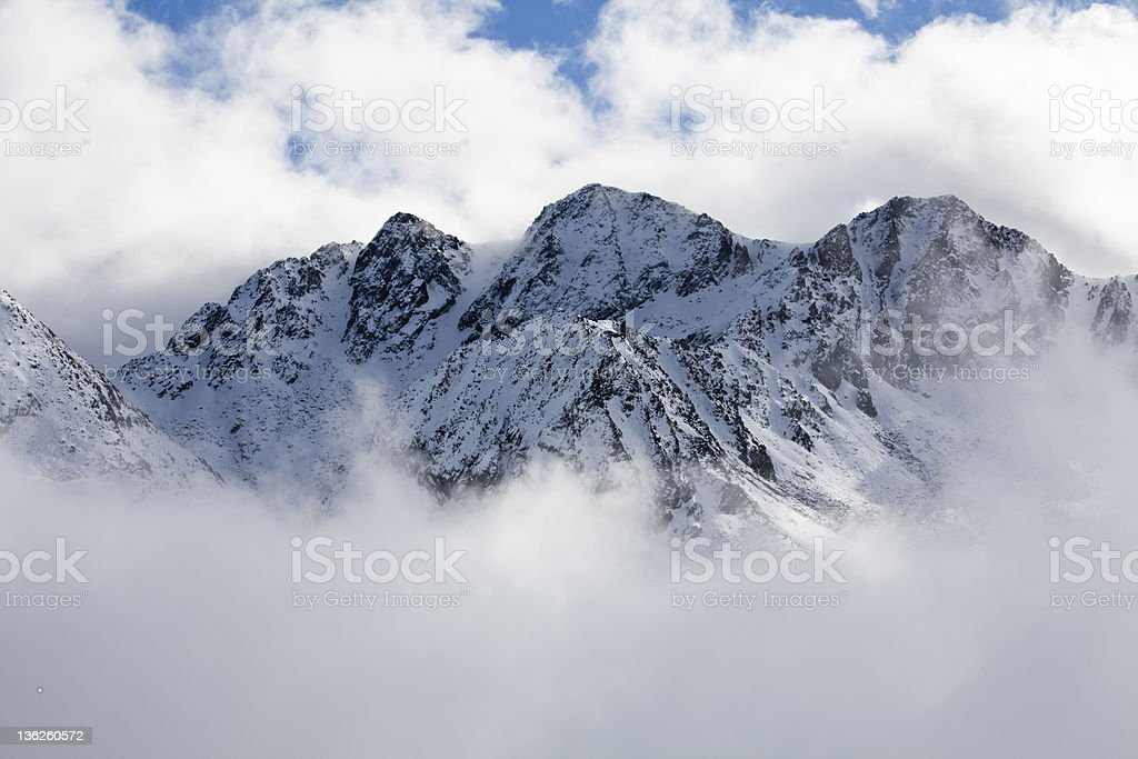 Peaks in the clouds royalty-free stock photo