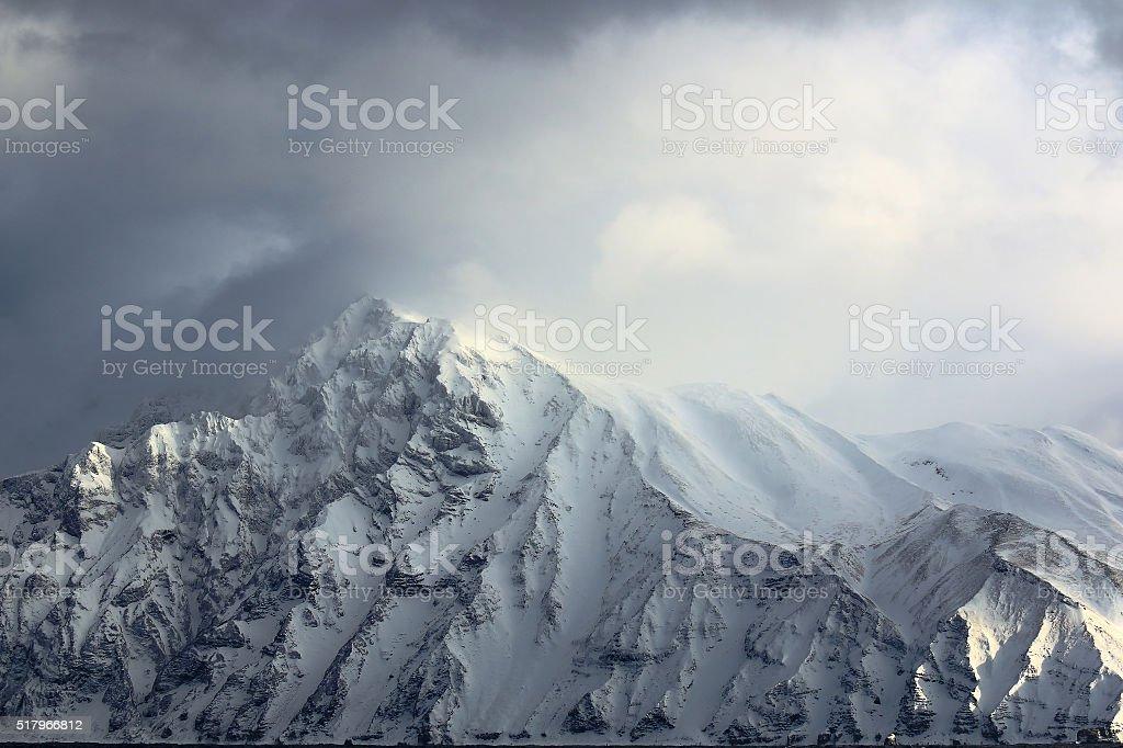Peaks in the winter sun beam lit stock photo