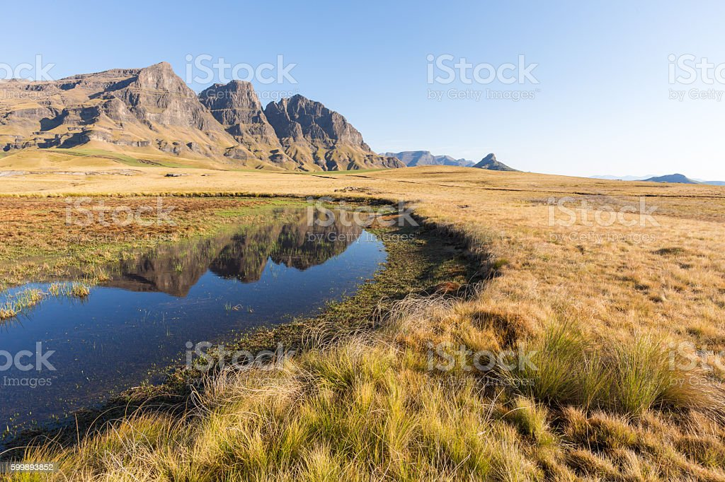 Peaks reflecting in pool stock photo