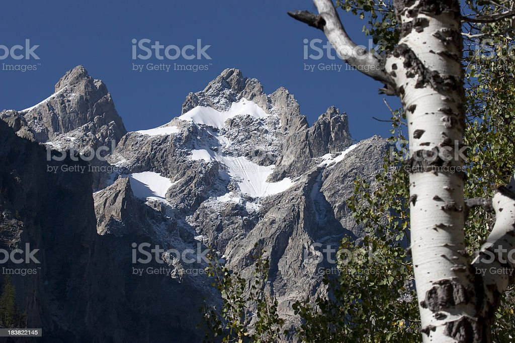 Peaks with cliffs and snow fields Grand Tetons National Park stock photo